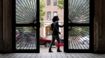 Dr. Jeanie Tse, chief medical officer at the Institute for Community Living, leaves a residence after meeting with a patient living with psychiatric disorders during her rounds, Wednesday, May 6, 2020, in the Brooklyn borough of New York. (AP / John Minchillo)