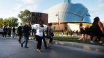 People gather in solidarity with the George Floyd protests across the United States at the Canadian Museum for Human Rights in Winnipeg, Friday, June 5, 2020. THE CANADIAN PRESS/John Woods