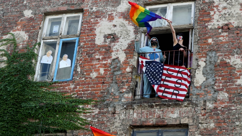 In this July 30, 2020 taken photo people occupied a house in support of LGBT protesters in Warsaw, Poland. (AP Photo/Czarek Sokolowski)