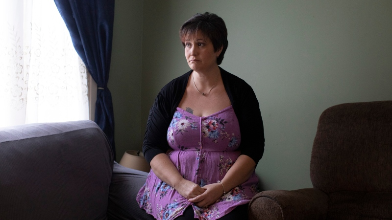 Karyn Keith, who receives CPP disabilities benefits, poses for a portrait in her home in Brampton, Ont., Monday, January 27, 2020. Karyn Keith says she isn't asking for much. (THE CANADIAN PRESS/Chris Young)