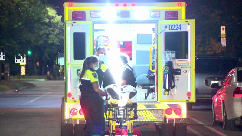 Paramedics load a 15-year-old and a 19-year-old into ambulances following an overnight shooting in Montreal North. / Cosmo Santamaria, CTV Montreal