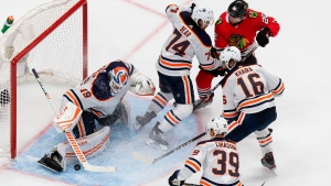 Edmonton Oilers goaltender Mikko Koskinen (19) makes a save against Chicago Blackhawks' Ryan Carpenter (22) during third period NHL Stanley Cup qualifying round action in Edmonton, Wednesday, Aug. 5, 2020. THE CANADIAN PRESS/Codie McLachlan