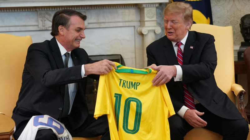 Brazilian President Jair Bolsonaro presents U.S. President Donald Trump with a Brazil national team jersey at the White House in Washington, DC, on March 19, 2019. (Credit: Pool / Getty Images North America / CNN)