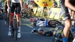 Cyclists are injured in a crash on the final stretch of the opening stage of the Tour de Pologne race in Katowice, Poland, on Aug. 5, 2020. (AP)
