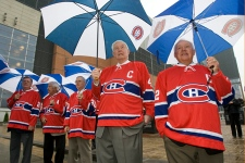 Former Montreal Canadiens Yvan Cournoyer, right, Jean Beliveau, Jean-Guy Morissette, Elmer Lach and Don Johns, left, attend a ceremony changing the name of the street in front of the Bell Center to Montreal Canadiens Avenue to mark the team's 100th anniversary Friday, October 9, 2009 in Montreal.
