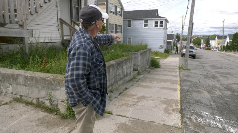 Timmins resident Robert Joseph points down the street to show CTV News where he lives. He says he's lived around the area of Fifth Avenue most of his life, but he no longer feels safe in the neighbourhood.  (Lydia Chubak/CTV News)