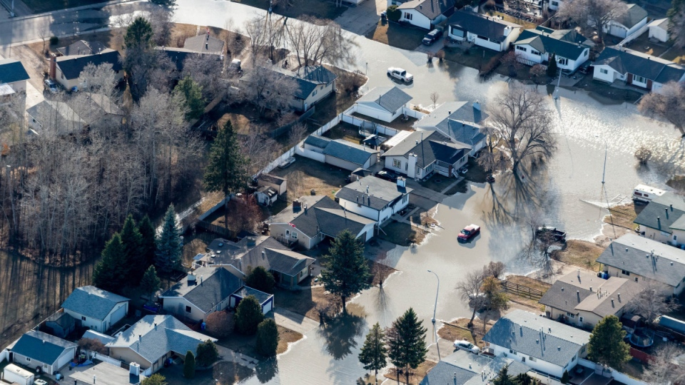 An aerial view of flooding in downtown Fort McMurray, Alta. on April 28, 2020. (Greg Halinda / THE CANADIAN PRESS)