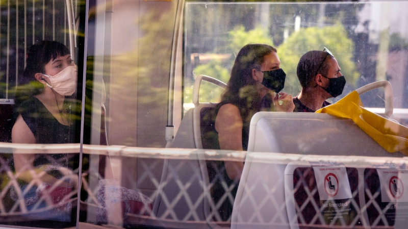 Toronto Transit Commission riders wear masks as they ride a streetcar in Toronto on Thursday, July 2, 2020. THE CANADIAN PRESS/Frank Gunn