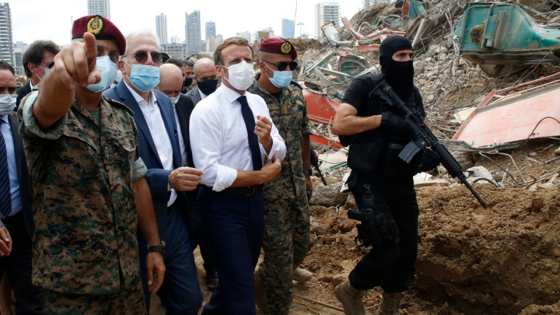 French President Emmanuel Macron, centre, visits the devastated site of the explosion at the port of Beirut, Lebanon, on Aug.6, 2020. (Thibault Camus / AP)