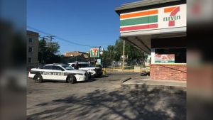 Winnipeg police on scene at a 7-Eleven in the city's West End.