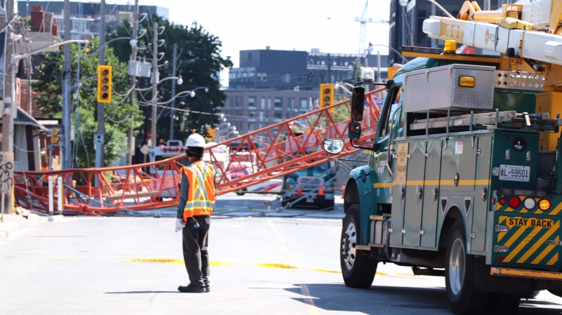 Emergency crews attend the scene of a crane collapse in downtown Toronto on Aug. 6, 2020. (Ted Brooks/CTV News Toronto)