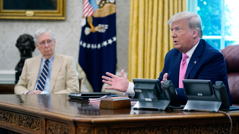 In this file photo, U.S. President Donald Trump meets with Senate Majority Leader Mitch McConnell, shown left, and House Minority Leader Kevin McCarthy, not shown, in the Oval Office at the White House, Monday, July 20, 2020, in Washington. Congress is just starting to negotiate new legislation to renew coronavirus aid. But the biggest obstacles to a deal are already coming into view. The Democratic House passed a whopping US$3.5 trillion coronavirus response bill more than two months ago and is demanding robust funding to help state and local governments. Republicans want to keep the bill closer to US$1 trillion and are insisting on new legal protections for schools, businesses, and charities that are trying to reopen. It's up to top congressional leaders to bridge the gaps as they negotiate with President Donald Trump's White House.(AP Photo/Evan Vucci)