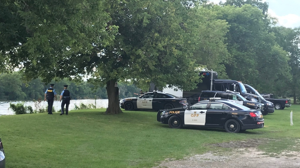 Police work to recover a body from the Grand River on Aug. 6, 2020 (Dan Lauckner / CTV News Kitchener)