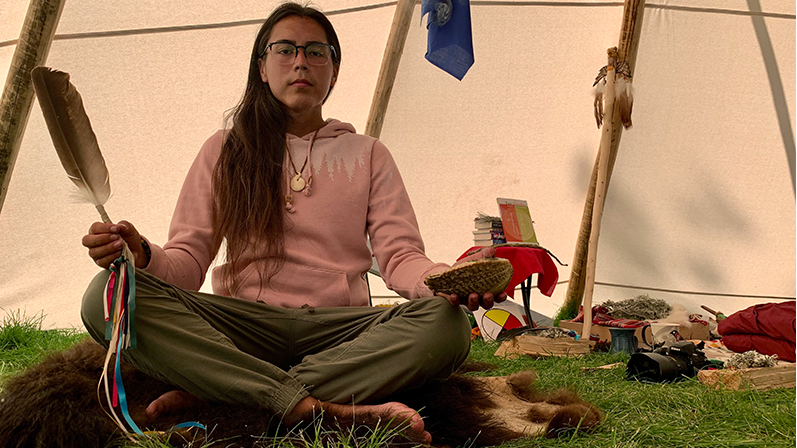 Tristen Durocher, a Metis fiddler who walked 635 kilometres to advocate for a provincial suicide prevention strategy, is pictured inside his tipi. (Michaela Solomon / CTV News Regina)