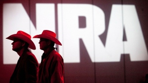 In this May 4, 2013, file photo, National Rifle Association members listen to speakers during the NRA's annual Meetings and Exhibits at the George R. Brown Convention Center in Houston. (Johnny Hanson/Houston Chronicle via AP, File)