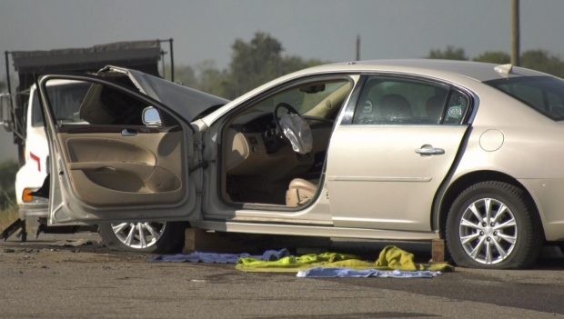 A heavily-damaged vehicle was seen at a crash along Highway 1 near Austin, Man.