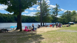Residents and municipal officials are concerned about crowded parking lots and sand at the Burnstown Beach during the COVID-19 pandemic. (Dylan Dyson/CTV News Ottawa)