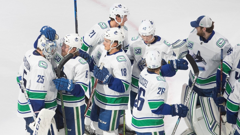 Vancouver Canucks celebrate the win following third period NHL qualifying round game action against the Minnesota Wild, in Edmonton, Thursday, Aug. 6, 2020. THE CANADIAN PRESS/Jason Franson