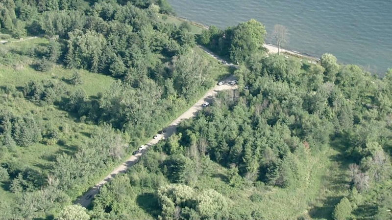 Emergency crews attend the scene after human remains are found near Lake Ontario on Aug. 6, 2020.