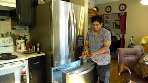 Jennifer Stephen McIntosh says she mistakenly bought a five-year-old fridge from Leon's. (Nicole Di Donato/CTV Saskatoon)