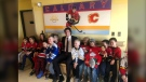 Flame Sean Monahan visits kids at Foothills Hospital after donating masks in partnership with Smile Zone