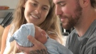 Frederique Grignon and her partner Nicholas Van Den Beld are seen with their new baby, Loki. Grignon ended up delivering her baby in a driveway after a local hospital sent her home to wait for contractions to increase.