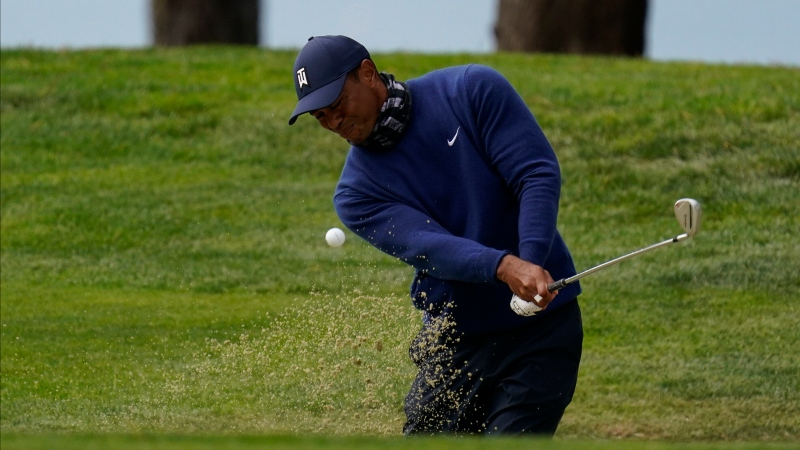 Tiger Woods hits from the bunker on the 14th hole during the first round of the PGA Championship golf tournament at TPC Harding Park Thursday, Aug. 6, 2020, in San Francisco. (AP Photo/Jeff Chiu)