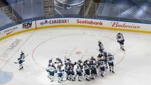 The Winnipeg Jets celebrate the win over the Calgary Flames during NHL qualifying round game action in Edmonton, on Monday August 3, 2020. THE CANADIAN PRESS/Jason Franson