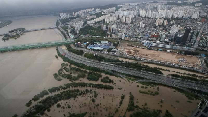 A part of a main road and a park near the Han River are flooded due to heavy rain in Seoul, South Korea, Thursday, Aug. 6, 2020. (AP Photo/Lee Jin-man)