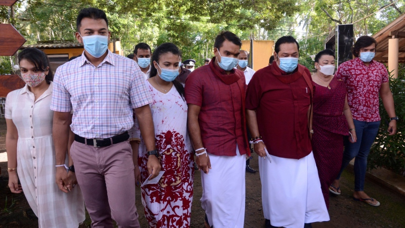 Sri Lankan Prime Minister Mahinda Rajapaksa, third right, his wife Shiranthi, second right, and family members arrive to cast their votes in their home village Madamulana, Sri Lanka, Wednesday, Aug. 5, 2020. (AP Photo/Pradeep Pathirana)