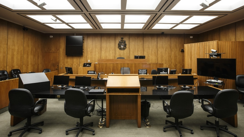 A courtroom at the Edmonton Law Courts building, in Edmonton on Friday, June 28, 2019. The Court of Queen's Bench of Alberta says jury selection and jury trials will resume next month. THE CANADIAN PRESS/Jason Franson