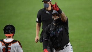 Miami Marlins' Jonathan Villar, right, celebrates a home run in Baltimore, on Aug. 6, 2020. (Nick Wass / AP)