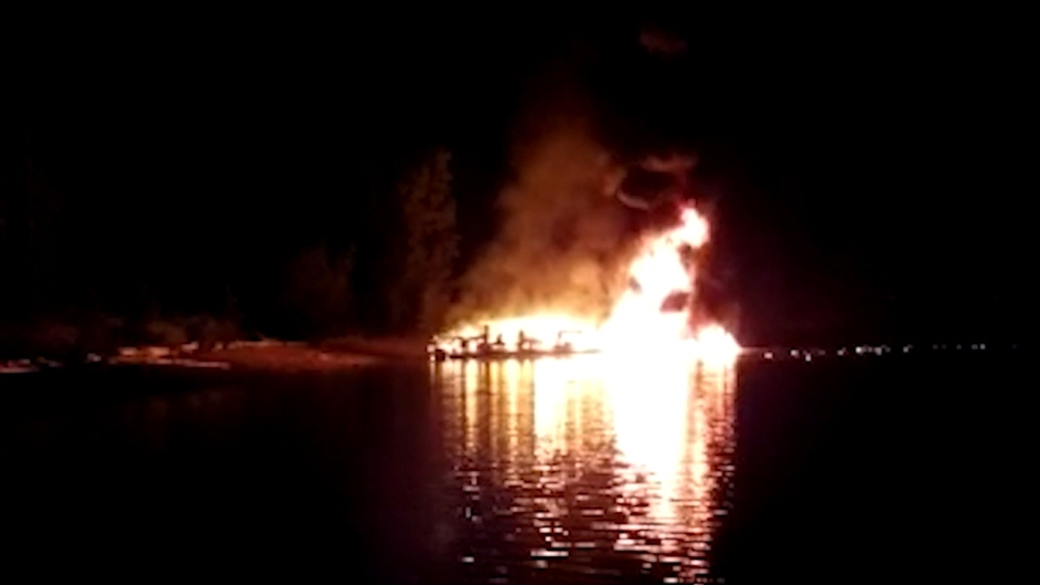 Flames seen shooting out of a houseboat on Mara Lake early in the morning of Aug. 4, 2020. (Submitted)