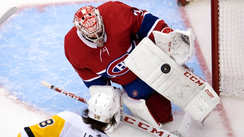 Montreal Canadiens goaltender Carey Price (31) makes a save on Pittsburgh Penguins defenceman Kris Letang (58) during third period NHL Eastern Conference Stanley Cup playoff action in Toronto on Wednesday, August 5, 2020. THE CANADIAN PRESS/Frank Gunn