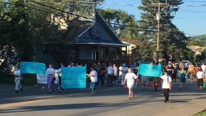 Hundreds of supporters walked in support of victims of sexual abuse and misconduct in Kahnawake Thursday Aug. 6, 2020.