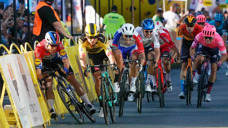 Fabio Jakobsen, left, hits side barriers at the start of a crash with Dylan Groenewegen, 2nd left, on the final stretch of the opening stage of the Tour de Pologne race in Katowice, Poland, on Aug. 5, 2020. (Tomasz Markowski / AP)