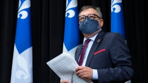 Horacio Arruda, Quebec director of National Public Health arrives at a news conference on the COVID-19 pandemic, Wednesday, June 17, 2020 at the legislature in Quebec City. THE CANADIAN PRESS/Jacques Boissinot