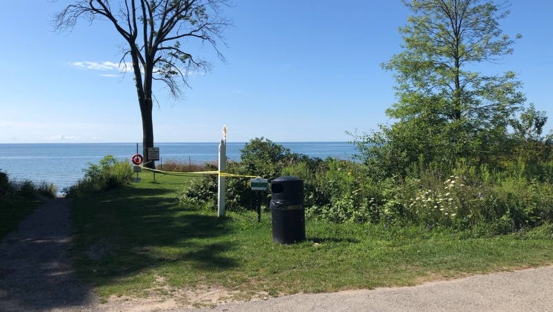 Police tape is seen along the shoreline of Lake Ontario in Pickering where the remains of a newborn infant were found. (Beth Macdonell)