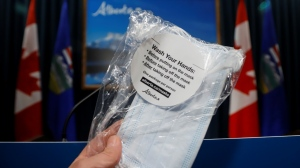 A package of four non-medical masks that will be available to Albertans to prevent the spread of COVID-19, in Calgary, Alta., Friday, May 29, 2020. THE CANADIAN PRESS/Jeff McIntosh​