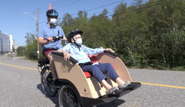 William McCormick, a volunteer at St. Joseph's Villa, takes 104-year-old Vera Leclair for a ride on a trishaw -- a motorized bike -- as part of the Cycling Without Age program. (Alana Everson/CTV News)