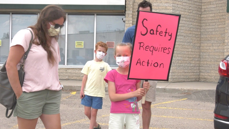 Protesters in front of Education Minister Gord Wyant's office on Aug. 7, 2020. (Laura Woodward/CTV Saskatoon)