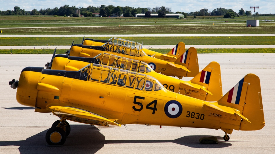 Harvard aircraft lined up on the runway at Region of Waterloo International Airport. (Courtesy: Waterloo Warbirds)