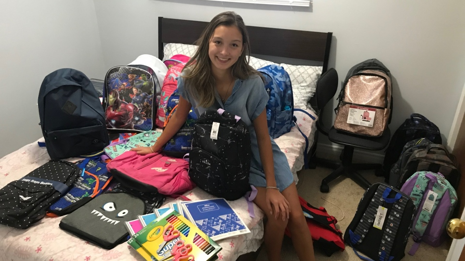 Katie Onesi, 17, of Kingston, Ont. is filling backpacks with school supplies to donate to families ahead of the new school year. (Kimberley Johnson / CTV News Ottawa)