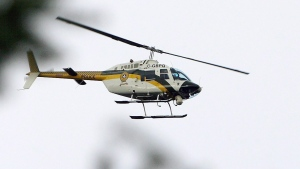 A Surete du Quebec helicopter is searching the Rouge River for the father of a four-year-old girl who was found drowned. THE CANADIAN PRESS/Sean Kilpatrick