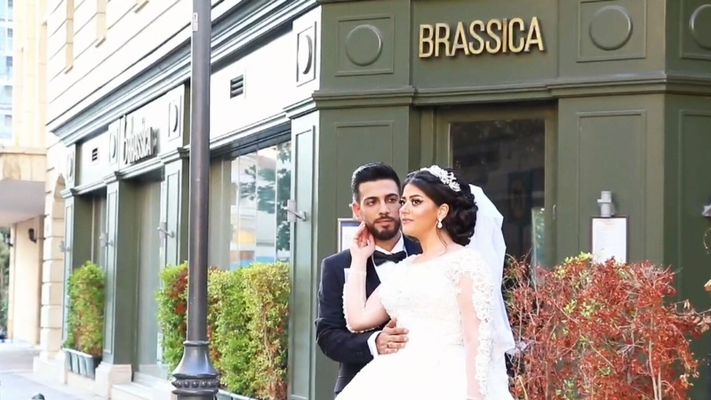 Wedding photographer Ibrahim Kitmitt captured the moment a newlywed couple's photoshoot was interrupted by the massive Beirut explosion on Tuesday. (Via Storyful)
