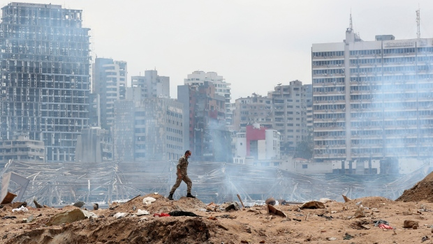 A soldier walks at the devastated site of the explosion in the port of Beirut, Lebanon, Thursday Aug.6, 2020. (AP Photo/Thibault Camus, Pool)