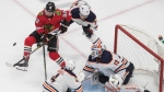 Edmonton Oilers goalie Mikko Koskinen (19) makes the save as Chicago Blackhawks' Alex Nylander (92) and Oilers' Oscar Klefbom (77) battle for the puck during third period NHL qualifying round game action in Edmonton, on Friday August 7, 2020. THE CANADIAN PRESS/Jason Franson