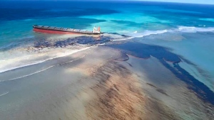 This photo taken and provided by Georges de La Tremoille of Mu Press shows oil leaking from the MV Wakashio, a bulk carrier ship that recently ran aground off the southeast coast of Mauritius, Friday, Aug. 7, 2020. (Georges de La Tremoille/MU press via AP)