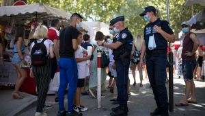 he glamorous French Riviera resort of Saint-Tropez is requiring face masks outdoors starting Saturday, threatening to sober the mood in a place renowned for high-end, free-wheeling summer beach parties. (AP Photo/Daniel Cole)