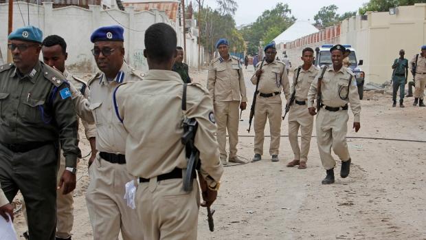 Somali police attend the scene where a suicide car bomber detonated near the gates of the motor vehicle imports duty authority headquarters near the port in Mogadishu, Somalia Saturday, July 4, 2020. (AP Photo/Farah Abdi Warsameh)